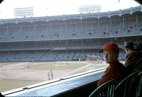 A young boy sits in the original Yankee Stadium in 1959